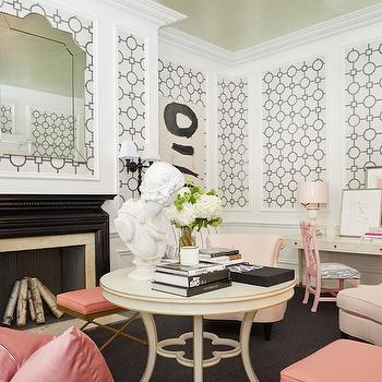 Tobi Fairley - living rooms - gold leaf ceiling, gold foiled ceiling, gold ceiling, pink black and white rooms, pink black and white living room, pink silk pillow, pink stool with gold base, gold stool with pink seat, round ivory accent table, round accent table with quatrefoil detail, tabletop vignettes, tabletop styling ideas, stacked art books, bust, glossy black fireplace surround, black lacquer fireplace, arched mirror, arched beveled mirror, wainscoting, wainscoting paneled walls, panels of wallpaper, wallpapered wainscoting panels, wallpaper and wainscoting, wallpaper over wainscoting, black and white wallpaper, geometric wallpaper, black and white fretwork wallpaper, ivory rolled back armchair, ivory accent chairs, living room arrangements, pink chippendale chair, pink desk chair, desk in living room, layered art, pink and green abstract, ivory urn shaped lamp, mary mcdonald lamps, charcoal gray carpet, dark gray carpeting, salmon pink pillows, quatrefoil table, black lacquered fireplace, wainscoting living room, black and white geometric wallpaper, phillip jeffries wallpaper, living room desk, pink desk chair,
