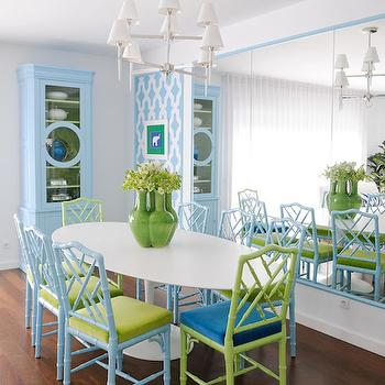 Maria Barros - dining rooms - framed mirror panels, oversize dining room mirror, mirrored dining room wall, modern nickel chandelier, jonathan adler chandelier, turquoise blue china cabinet, glass front turquoise china cabinet, oval saarinen dining table, white oval dining table, modern oval dining table, green vase, panels of wall stenciling, moroccan tile wall stencil, turquoise blue moroccan tile stencil, green chinese chippendale chair, faux bamboo dining chair, lime green chair with blue seat, turquoise chair with green seat, turquoise chinese chippendale chair, modern blue and green dining room, stenciled art panels, turquoise trellis stencil, trellis stencil, trellis stenciled art panels, faux bamboo chairs, turquoise bamboo chairs, green bamboo chairs, peacock blue seat cushions, blue china cbainet, turquoise china cabinet, turquoise trellis stenciled panels, moroccan stenciled art panels, turquoise moroccan stencils,