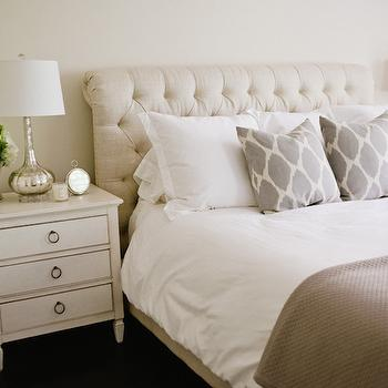 Style Me Pretty - bedrooms - beige walls, beige wall color, three drawer nightstand, ivory nightstand, traditional ivory nightstand, mercury glass table lamp, white bedding, taupe coverlet, gray ikat dot pillow, beige linen tufted headboard, button tufted linen headboard, upholstered sleigh headboard, upholstered tufted sleigh headboard, neutral bedroom, neutral bedroom schemes, feminine bedrooms, ikat dot pillows, beige bedrooms, white and beige bedrooms, neutral bedrooms, mercury glass lamps, restoration hardware beds, chesterfield bed, beige chesterfield bed,
