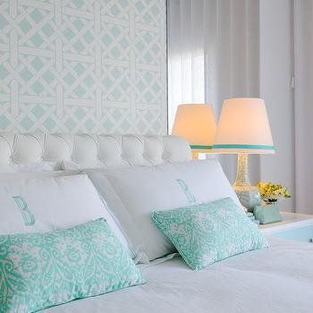 Maria Barros - bedrooms - aqua ikat pillow, aqua ikat lumbar pillow, monogrammed pillow shams, aqua blue monogrammed pillows, monogrammed bed linens, white button tufted headboard, white tufted headboard, aqua blue lattice wallpaper, aqua blue fretwork wallpaper, wallpapered headboard wall, crackle glaze table lamp, grosgrain trimmed lamp shade, white nightstand with turquoise drawers, white and aqua nightstand, white and aqua bedroom, white and aqua blue bedroom ideas, mirror behind nightstand, mirror panel behind nightstand, aqua lattice wallpaper, aqua trellis wallpaper, aqua bedrooms,