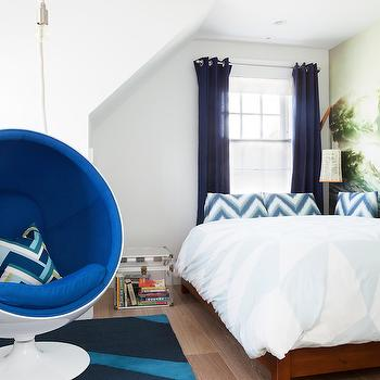 Reiko Feng Shui Design - boy's rooms - white and blue boys room, bed in front of window, bed under window, platform bed, wood platform bed, kids beds, kids platform bed, chevron pillows, blue chevron pillows, grommet curtains, grommet drapes, blue grommet drapes, blue grommet curtains, navy curtains, navy draper, navy grommet curtains, navy grommet drapes, lucite trunk, ball chair, blue ball chair, blue geometric rug, contemporary boys room, contemporary kids room,