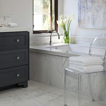 Studio Surface - bathrooms - black sink vanity, black washstand, dresser like vanity, dresser sink vanity, dresser washstand, dresser like washstand, black dresser vanity, black dresser washstand, white marble floor, white quartz countertops, black vanity white quartz countertop, 3 drawer vanity, 3 drawer sink vanity, 3 drawer washstand, black 3 drawer vanity, black 3 drawer washstand, marble clad bathtub, marble tub surround, marble bathtub surround, gooseneck tub filler, bathroom chair, bathroom ghost chair, ghost chair bathroom,