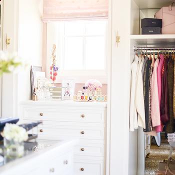 Pink Peonies - closets - closet island, island closet, glass top closet island, built ins, closet built ins, mirrored backsplash, closet backsplash, built in backsplash, closet built in backsplash, built in dresser, tall boy dresser, pink roman shade, dream closets, walk in closets, walk in closet ideas, master bedroom closets,