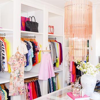 Pink Peonies - closets - closet island, island closet, glass top closet island, pink chandelier, pink fringe chandelier, pink glass chandelier, necklace bust, pink tiered chandelier, built ins, closet built ins, mirrored backsplash, closet backsplash, built in backsplash, closet built in backsplash, built in dresser, tall boy dresser, pink roman shade, dream closets, walk in closets, walk in closet ideas, master bedroom closets, closet chandelier, floor to ceiling built ins, floor to ceiling closet built ins, polka dot roman shade, pink polka dot roman shade,