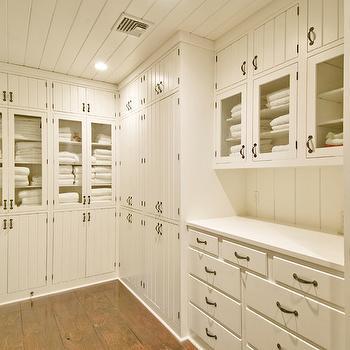 Hamptons Habitat - closets - linen closet, walk-in linen closet, beadboard cabinets, beadboard linen cabinets, floor to ceiling built ins, floor to ceiling built in cabinets, glass door linen cabinets, glass front linen cabinets, built in linen cabinets,