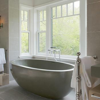 Brooks & Falotico - bathrooms - windowed tub alcove, bath alcove, bathtub alcove, freestanding gray tub, oval shaped gray tub, gray bathtub, modern tub filler faucet, floor mount towel rack, floor mount towel rail, gray stone tile, large gray stone tile, oversize floor tile, oversize gray tile, chunky gray counters, thick gray counters, wall mount vanity, modern wall mount vanity, rectangular wooden mirror, contemporary wooden vanity mirror, tubular wall sconce, iron and glass wall sconce, dual vanities, his and hers vanities, symmetrical bathroom ideas, symmetrical bathroom layouts, bathtub nook, tub nook, nook for tubs, nook for bathtub, gray tub, modern gray tub, modern gray bathtub, veneer washstands, floating washstands, floor mounted towel warmers,