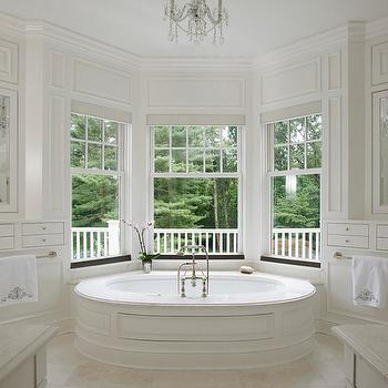 Brooks & Falotico - bathrooms - oval shaped tub, oval drop in tub, wainscoting paneled tub, paneled drop in tub, bathroom bay window, tub in bay window, marble tub deck, counter mount faucet, nickel towel rail, monogrammed towel, monogrammed bath towel, mirrored cabinet doors, bathroom built ins, transitional bathroom, white bathroom cabinets, built in bathroom cabinetry, crystal chandelier, symmetrical bathroom ideas, mirrored door fronts, ceiling height bathroom built ins, bathroom bay window, oval bathtub, wainscoted tub, wainscoted bathtub, bay window bathroom, bay window bathtub, bathtub bay window, his and her vanities, framed medicine cabinets, built in towel rails, built in towel holders,