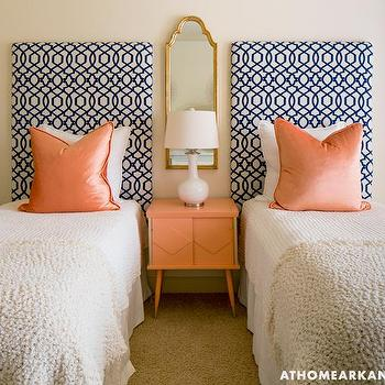 At Home in Arkansas - bedrooms - guest bedroom ideas, twin guest beds, twin guest bedroom ideas, navy fretwork headboard, fretwork print headboard, ivory chenille bedspread, ivory wool blanket, vintage orange nightstand, mid century orange nightstand, orange nightstand, white ceramic table lamp, orange velvet pillow, arched gold mirror, arched gilt mirror, mirror over nightstand, tan walls, tan wall color, orange sherbet pillows, orange sherbet table, navy trellis headboard, white and navy headboards, trellis headboard, shared nightstand, blue and orange bedrooms, navy and orange bedrooms, orange velvet pillows, orange pillows,