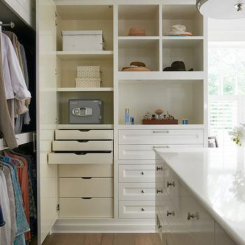 Brooks & Falotico - closets - closet island, closet jewelry island, white counters, round nickel cabinet pulls, closet hardwood floors, double stacked clothes rails, closet drawers, built in closet drawers, built in closet dresser, open closet shelving, nickel drum pendant, nickel lattice drum pendant, custom closet ideas, custom closet island, dream walk in closets, floor to ceiling closet built ins, jewelry island, accessory island, secret cabinet, secret closet cabinet, closet safe, closet safe ideas, built in dresser, closet built ins, closet chandelier, lattice light pendant,