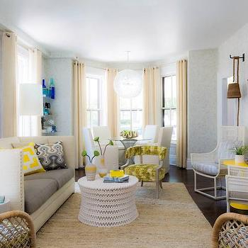 Rachel Reider Interiors - living rooms - high back sofa, 2 tone sofa, two tone sofa, white and gray sofa, white sofa with gray cushions, 2 cushion sofa, art over sofa, turquoise abstract art, yellow and turquoise art, turquoise art, turquoise and yellow abstract art, yellow and gray pillows, white coffee table, oly studio coffee table, jute rug, yellow and gray chair, wicker chairs, yellow accent table, yellow table, wicker chairs, dome chairs, wicker dome chairs, long living rooms, cream curtains, cream drapes, cream grommet curtains, cream grommet drapes, bay window, living room bay window, bay window living room, round dining table, round game table, bay window table, rope sconces, long living rooms, , Pipa Coffee Table,