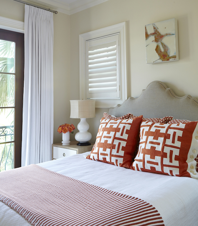Tracery Interiors - bedrooms - Berkeley Small Side Table, red and beige bedrooms, butter cream walls, butter cream wall paint, art over bed, beige headboard, beige linen headboard, nailhead headboard, studded headboard, beige nailhead headboard, beige studded headboard, white and red pillows, red geometric pillows, striped throw, striped throw blanket, red stripe throw, red striped blanket, 2 tone nightstand, 3 drawer nightstand, bungalow 5 nightstand, white double gourd lamp, orange roses, seaside bedroom, beach cottage bedrooms,