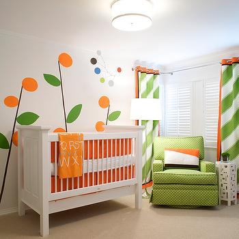 Elizabeth Kimberly Design - nurseries - green and orange nursery, contemporary nursery, nursery wall decal, paneled crib, paneled nursery crib, orange crib bedding, green glider, polka dot glider, green polka dot glider, green curtains, grommet curtains, green grommet curtains, diagonal stripe curtains, diagonal striped curtains, diagonally striped curtains, green diagonal striped curtains,