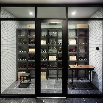 Dan Scotti Design - basements - wine cellar, glass wine cellar, basement wine cellar, wine cellar basement, subway tiles, floor to ceiling subway tiles, metal wine racks, metal wine shelves, black stool, dark gray tiles,