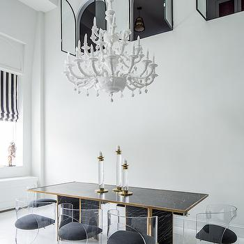 James Dixon Architecture - dining rooms - 2 story dining room, two story dining room, white chandelier, black dining tables, black and gold dining tables, black dining table with gold trim, lucite dining chairs, lucite barrel back dining chair, lucite chairs, white plank floor, striped roman shade, black and white roman shade, black and white striped roman shade,