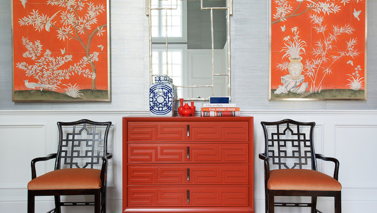 Morgan Harrison Home - entrances/foyers - framed chinoiserie panel, orange framed chinoiserie panel, framed chinoiserie wallpaper panels, silver faux bamboo mirror, faux bamboo mirror, orange greek key chest, orange chest of drawers, chest with greek key overlay, greek key overlay, wainscoting half wall, paneled half wall, light gray grasscloth, grasscloth wallpaper, gray grasscloth wallpaper, stacked books, entryway vignette, chinoiserie entryway, chinoiserie foyer, blue and white ginger jar, orange bud vase, black chinese chippendale chair, chinese chippendale arm chair, black chair with orange velvet seat, chinoiserie art panels, orange chinoiserie art panels, wallpapered art panels, orange art panels, silver bamboo mirror, orange chest, orange dresser, greek key chest, orange fretwork chest, foyer wainscoting, wainscoting foyer,