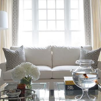 Morgan Harrison Home - living rooms: gray geometric rug, gray and ivory geometric rug, nickel and glass accent table, accent tables as coffee table, round silver tray, silver mirrored tray, art books, nickel accent table with glass top, ivory drapes with gray tape trim, ivory drapes with geometric trim, gray and ivory living room, gray and cream living room, crystal balustrade table lamp, black accent table, gray walls, dark gray walls, chair rail trim, dark walls with light chair rail, crystal table lamp, ivory rolled arm sofa, ivory rolled arm settee, gray geometric pillows, gray velvet pillow, gray geometric velvet pillow, mary mcdonald fabric, mary mcdonald curtain tape, mary mcdonald tape trim, glass column floor lamp, glass and nickel floor lamp, sofa in front of window, ivory and gray living rooms, ivory chair rail, living room chair rail, chair rail living room, ivory and gray rug, side by side coffee tables, ivory curtains, ivory drapes, ivory sofa, roll arm sofa, sofa in front of window,