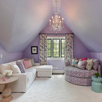 2 Design Group - girl's rooms: lilac colored walls, purple walls, purple wall color, dormer ceiling, dormer ceiling girls room, purple walls and ceiling, painted ceiling, crystal chandelier, ivory sectional sofa, ivory sectional with chaise, purple zebra print pillow, pink geometric pillow, turned wood pedestal table, floral curtains, steel framed window, purple accent chair, round lounge chair, zebra print lounge chair, girls hangout room, union jack pillow, ivory area rug, dark hardwood floors, aqua blue ceramic stool, aqua blue garden stool, teen hangout room, purple girls room, ivory sofa with chaise, purple chair, round chair, round purple chair, zebra chair, round zebra chair,