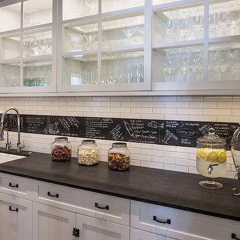 Norman Design Group - kitchens - sliding glass cabinets, sliding glass kitchen cabinets, sliding glass upper cabinets, black and white butlers pantry, black and white wet bar, built in wet bar, square porcelain sink, porcelain bar sink, spray faucet, modern spray faucet, beadboard front cabinets, white beadboard cabinets, oil rubbed bronze cabinet hardware, white subway tile, chalkboard paint on slate, chalkboard paint backsplash border, backsplash border ideas, chalkboard paint in kitchen ideas, under cabinet lighting, chalkboard paint backsplash ideas, lit glass front cabinets, kitchen chalkboard, chalkboard tiles, slate tiles, slate chalkboard tiles, beadboard cabinets, beadboard kitchen cabinets, beadboard cabinet doors, butler pantry chalkboard, butlers pantry chalkboard ideas,