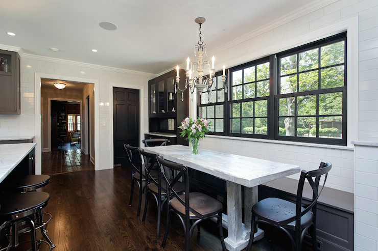 2 Design Group - kitchens - eat in kitchen, dine in kitchen, window seat dining bench, built in dining bench, gray dining bench, black french cafe chairs, french cafe chair, french chandelier, carved wood and iron chandelier, black sash windows, black framed windows, black kitchen hutch, built in china hutch, kitchen hutch, elongated subway tile, floor to ceiling wall tile, black interior doors, black pantry doors, industrial counter stool, eat in kitchen ideas, dining bench window seat, banquette window seat, window seat banquette, black cafe chairs, black cafe dining chairs, built in banquette, black hutch cabinet, whitewashed dining table, white distressed dining table,