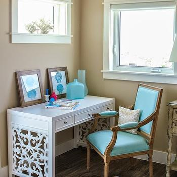 Wendy Patrick Designs - dens/libraries/offices - camel walls, camel colored walls, window over desk, desk below window, seashell art, seaglass vase, white fretwork paneled desk, white fretwork desk, white scrolled fretwork desk, square back french chair, square back french arm chair, seaglass blue french chair, aqua blue french chair, home office ideas, window molding, window trim, white desk, lattice desk, white lattice desk, turquoise chair, turquoise desk chair, corner desk,