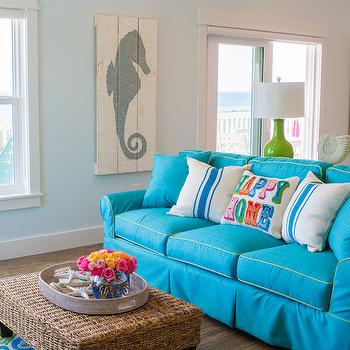 Wendy Patrick Designs - living rooms - green and turquoise living room, beach living room ideas, coastal living room ideas, turquoise and lime green living room ideas, turquoise sofa, turquoise sofa with green piping, turquoise slipcovered sofa, sofa table, blue walls, light blue walls, seahorse art, wood paneled seahorse art, beach house art, sliding patio doors, seagrass ottoman, seagrass ottoman coffee table, oval tray, fresh cut flowers, green and turquoise rug, lime green and turquoise rug, green and turquoise tile rug, blue striped pillow, happy home pillow, green table lamp, green ceramic table lamp, lime green table lamp, seaside living room, turquoise couch, turquoise slipcovered sofa, ottoman coffee table, seagrass ottoman coffee table, green table lamps, seahorse art panels, seahorse art, cottage art, beach cottage art,