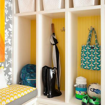 Tobi Fairley - laundry/mud rooms - yellow and gray mud room, built in mud room bench, mud room storage bench, yellow gray and white cushion, gray and white floral wallpaper, gray and white botanical wallpaper, yellow beadboard, beadboard backed mud room closets, beadboard lined mud room lockers, yellow beadboard, nickel coat hooks, mud room storage drawers, mud room cubbies, white baskets, white woven baskets, wallpaper in mud room, family friendly mud room, mud room locker ideas, mud room built in ideas, mudroom wallpaper, wallpaper for mudrooms, mudroom bench, built in mudroom bench, yellow and gray cushion, mudroom lockers, open mudroom lockers, gray floral wallpaper, modern floral wallpaper, painted backs of lockers, painted backs of built ins, beadboard lined lockers, beadboard mudroom lockers, mudroom cubbies,