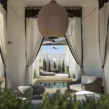 Alys Beach - decks/patios - mediterranean deck, mediterranean patio, outdoor curtains, outdoor drapes, black and white curtains, black and white outdoor curtains, outdoor chairs, outdoor furniture, gray poufs, outdoor poufs, in ground pool, moroccan lantern, moroccan pendants,