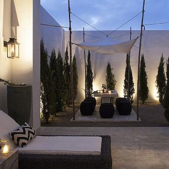 Alys Beach - decks/patios - concrete planters, mediterranean patio, mediterranean deck, outdoor lounge, chevron pillows, alfresco dining, dining canopy, outdoor canopy, outdoor dining canopy, concrete dining table, outdoor dining ideas,