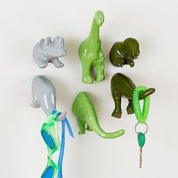Art/Wall Decor - Prehistoric Wall Hooks | The Land of Nod - dinosaur wall hooks, dinosaur shaped wall hooks, dinosaur wall decor,