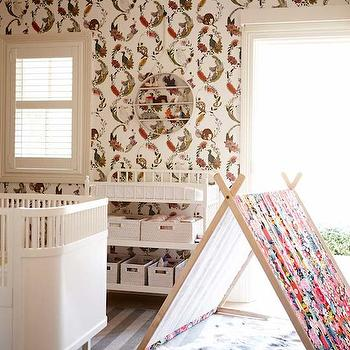 The Grace Tales - girl's rooms - kids tent, folding wooden kids tent, sheepskin rug, gray striped rug, tonal gray striped rug, white crib with rounded corners, contemporary white crib, white changing table, jenny lind changing table, white woven baskets, animal wallpaper, kids animal wallpaper, bird and animal print wallpaper, whimsical animal wallpaper, eclectic animal wallpaper, round shelf, round wall shelf, round trinket shelf, nursery wallpaper ideas, wallpaper in nursery, wallpapered nursery, tone on tone rug, gray striped rug, rounded corners crib,