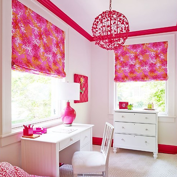 Laura Casey Interiors - girl's rooms - red crown molding, red baseboards, pink geometric circle beanbag, hot pink geometric beanbag, contrasting crown molding, cream diamond print rug, geometric cream rug, white spindle back chair, white beadboard desk, white kids desk, beadboard kids desk, white dresser with bun feet, white cottage style desk, white cottage style dresser, pink upholstered memo board, pink memo board, girls homework room, girls hang out room, hot pink and orange roman shade, pink and orange abstract print shade, pink floral sphere chandelier, pink floral sphere pendant light, pink beanbag, beadboard desk, kids desks, desk under window, desk below window, pink and orange roman shades, kids window treatments, kids roman shades,