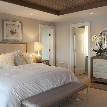 Michael Greenberg and Associates - bedrooms: waterfront homes, planked ceiling, planked tray ceiling, bedroom tray ceiling, tray bedroom ceiling, queen bed, cream sheepskin pillows, python bench, faux python bench, bench at foot of the bed, metal framed headboard, upholstered headboard, mirrored nightstands, 3 drawer nightstands, 3 drawer mirrored nightstands, beige rug, rug under bed, two tone dresser, 2 tone dresser, 3 drawer dressers, metal convex mirror, his and her closets,