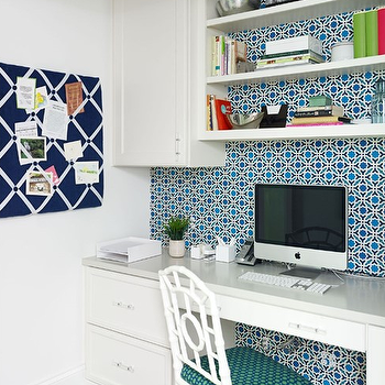 Laura Casey Interiors - dens/libraries/offices: navy and white memo board, grosgrain trimmed memo board, white built in desk, built in desk, built in desk with shelves, light gray counters, light gray countertops, white faux bamboo side chair, white faux bamboo chair, betwixt print chair, betwixt fabric chair, green and blue tile wallpaper, green and blue retro wallpaper, wallpaper behind built in desk, desk with shelves above, built in desk with shelving, built in desk with upper cabinets, built in home office, navy memo board, navy pin board, ribbon trimmed pin board, builtin desk, shelves over desk, chloe chair, wallpaper as backsplash, wallpaper backsplash, wallpapered backsplash,