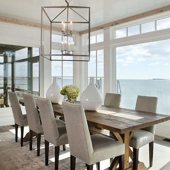 Michael Greenberg and Associates - dining rooms - dining room lanterns, chrome and glass lanterns, salvaged wood dining table, trestle dining table, salvaged wood trestle dining table, planked dining table, gray linen dining chairs, gray dining chairs, gray rug,