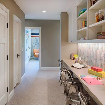 Studio M Interiors - dens/libraries/offices - taupe walls, taupe wall color, beige carpet, beige wall to wall carpet, wall length built in desk, kids homework station, kids homework desk, hallway home office, hallway homework desk, hallway homework station, built in office cabinets, taupe counter, weathered plank backsplash, wood plank effect backsplash, plank effect wallpaper, tolix chair, metal desk chair, industrial desk chair, hallway closet, oiled bronze door knobs, homework station, homework space, homework space ideas, hall homework space, hallway homework space,