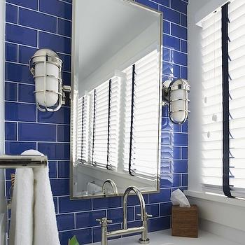 Lynn Morgan Design - bathrooms - kids bath, kid bathroom, blue subway tiles, nautical bathroom, nautical kids bathroom, blue bathroom backsplash, maritime sconces, nautical sconces, pivot mirror, rectangular pivot mirror, white washstand, square sink, square vanity sink, bridge faucet, deck faucet, bridge deck faucet, nautical bathroom sconces, white and blue bathrooms, white and blue kids bathrooms,