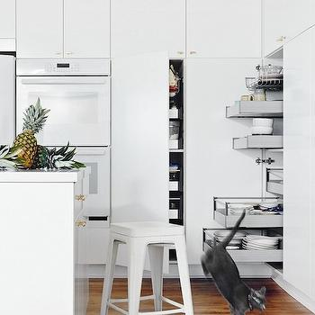 Domaine Home - kitchens - white kitchens, white kitchen ideas, floor to ceiling cabinets, floor to ceiling kitchen cabinets, white kitchen cabinets, brass hardware, pantry, built in pantry, pantry shelves, pull out pantry shelves, white ovens, double ovens, white double ovens, kitchen island, white tolix stool, tolix stool,