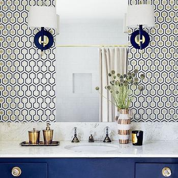 Domaine Home - bathrooms - hicks wallpaper, hexagon wallpaper, hicks hex wallpaper, hicks hexagon wallpaper, hex wallpaper, hexagon wallpaper, blue and gold wallpaper, blue hex wallpaper, david hicks wallpaper, jonathan adler sconces, frameless vanity mirror, blue vanity, blue sink vanity, blue washstand, vanity sconces,