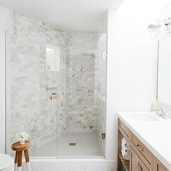 Lynn Morris Contracting - bathrooms - long bathrooms, long master bath, long master bathroom, angled shower, angled walk in shower, walk in showers, marble subway shower tiles, marble subway tiled shower, curved shower, curved walk in shower, tiled shower niche, bathroom stool, 2 tone stool, light brown double washstand, light brown vanity, light brown sink vanity, white quartz countertops, hex shower floor, white hex shower floor,
