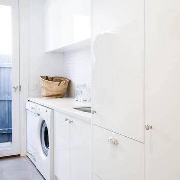 Rosemount Kitchens - laundry/mud rooms - modern laundry room, laundry room, modern laundry room ideas, laundry room cabinets, white lacquer cabinets, white lacquered cabinets, white washer dryer, laundry room sink, long laundry room,