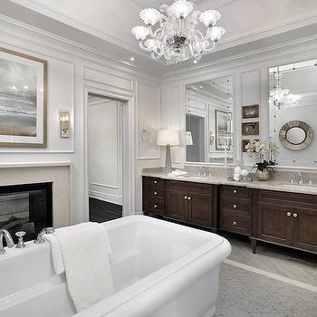 Tomas Pearce Interior Design - bathrooms: master baths, traditional baths, traditional bathrooms, bathroom fireplace, master bath fireplace, master bathroom fireplace, double sided fireplace, see through fireplace, see through double sided fireplace, double sided see through fireplace, freestanding bathtub, mosaic marble tiles, mosaic marble floor, wall moldings, bathroom wall moldings, decorative wall moldings, his and her vanities, his and her washstand, full wall washstand, full wall vanity, chocolate brown vanity, chocolate brown washstand, chocolate brown double vanity, chocolate brown double washstand, gray countertops, etched mirrors, etched vanity mirror, silver table lamps, tray ceiling, tray bathroom ceiling, chandelier over bathtub,