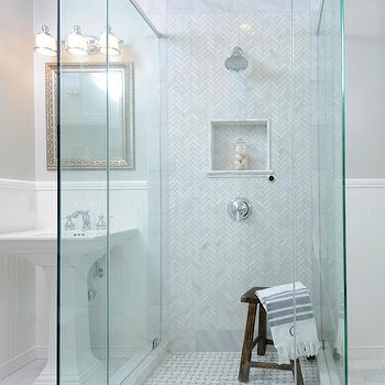 Luxe Design Build - bathrooms: seamless glass shower, walk in shower, walk in shower ideas, herringbone tiles, marble herringbone tiles, herringbone shower tiles, marble herringbone shower tiles, herringbone shower surround, marble herringbone shower surround, shower niche, tiled shower niche, shower stool, basketweave shower floor, marble basketweave shower floor, pedestals ink, hammered mirror, silver hammered mirror, triple light sconce, half painted walls, half beadboard walls, beadboard trim, bathroom beadboard, beadboard trim bathroom,