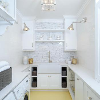 Luxe Design Build - laundry/mud rooms - white and yellow laundry rooms, long laundry room, flush mount, laundry room lighting, laundry room flush mount, laundry room cabinets, crisp white cabinets, white quartz countertops, laundry room shelves, laundry room shelving, shelf over sink, over the sink shelf, laundry room floating shelf, laundry room floating shelves, farmhouse sink, laundry room sink, gooseneck faucet, laundry room cubbies, laundry room bins, pull out bins, cabinet over washer and dryer, white washer and dryer, mosaic tiled backsplash, laundry room backsplash, laundry room lighting,