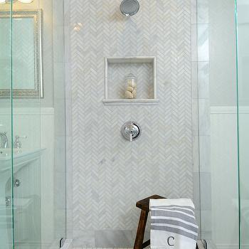 Luxe Design Build - bathrooms - seamless glass shower, walk in shower, walk in shower ideas, herringbone tiles, marble herringbone tiles, herringbone shower tiles, marble herringbone shower tiles, herringbone shower surround, marble herringbone shower surround, shower niche, tiled shower niche, shower stool, basketweave shower floor, marble basketweave shower floor, pedestals ink, hammered mirror, silver hammered mirror, triple light sconce, half painted walls, half beadboard walls, beadboard trim, bathroom beadboard, beadboard trim bathroom, carrera marble, carrera herringbone tiles, carrera marble herringbone tiles, carrera shower tiles, carrera marble shower tiles, polished carrera marble, polished carrera marble tiles,