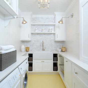 Luxe Design Build - laundry/mud rooms - white and yellow laundry rooms, long laundry room, flush mount, laundry room lighting, laundry room flush mount, laundry room cabinets, crisp white cabinets, white quartz countertops, laundry room shelves, laundry room shelving, shelf over sink, over the sink shelf, laundry room floating shelf, laundry room floating shelves, farmhouse sink, laundry room sink, gooseneck faucet, laundry room cubbies, laundry room bins, pull out bins, cabinet over washer and dryer, white washer and dryer, mosaic tiled backsplash, laundry room backsplash,