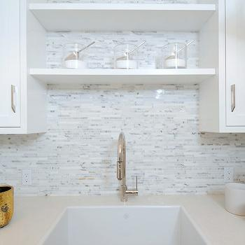 Luxe Design Build - laundry/mud rooms - laundry room, laundry room cabinets, crisp white cabinets, white quartz countertops, laundry room shelves, laundry room shelving, shelf over sink, over the sink shelf, laundry room floating shelf, laundry room floating shelves, farmhouse sink, laundry room sink, gooseneck faucet, linear marble tiles, linear white marble tiles, linear marble backsplash,