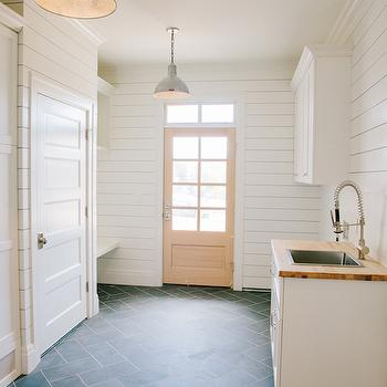 Tiek Built Homes - laundry/mud rooms - steel dome pendant, industrial steel pendant light, herringbone floor tile, herringbone slate tiled floors, slate floor tile, shiplap paneling, laundry room shiplap, horizontal wood paneling, laundry mud room combo, combination laundry mud room, utility sink, stainless steel utility sink, spray faucet, spray head faucet, floating mud room bench, mud room cubbies, wooden back door, glass paned back door, transom window, transom window over door, wooden counter, butcher block counter, laundry room lighting, cottage laundry rooms, slate tiles, laundry room floor tiles, slate herringbone tiles, slate herringbone floor, laundry room sink, laundry room bench laundry room cubby,