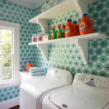 Urban Home Magazine - laundry/mud rooms - side by side washer and dryer, front load dryer, top load washer, white washer, white dryer, turquoise and red wallpaper, retro turquoise and red wallpaper, wallpapered laundry room, laundry room wallpaper, corbel shelf brackets, corbel shelves, laundry room shelves, laundry room shelving, retro wallpaper, retro patterned wallpaper, laundry shelves, laundry room shelves, laundry shelving, laundry room shelving, shelf with corbels, shelves with corbels, shelves over washer and dryer, shelving over washer and dryer,