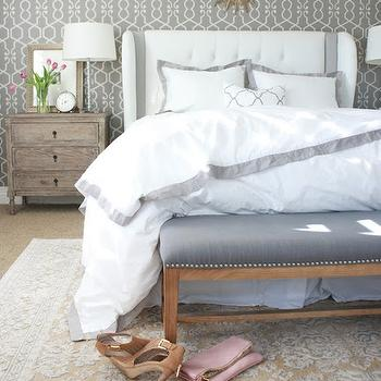 A Thoughtful Place - bedrooms - gold and gray rug, rug under bed, gray bench, gray nailhead bench, bedroom bench, bench at foot of the bed, white headboard, white wingback headboard, white tufted headboard, white and gray bedding, white and gray shams, white and gray duvet, border bedding, border shams, border duvet, gray border bedding, gray border shams, gray border duvet, distressed nightstand, 3 drawer nightstand, mirror over bed, gold sunburst mirror, small sunburst mirror,