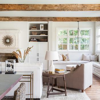 Marie Flanigan Interiors - living rooms - rustic wood beams, living room beams, living room ceiling beams, built ins, built in shelves, living room built ins, wallpapered backs of shelves, living room natural stone fireplace, sunburst mirror, mirror over fireplace, fireplace mirror, living room window seat, built in window seat, L shaped window seat,